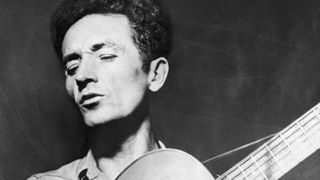 Woody guthrie playing guitar