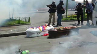 H4 bolivia soldiers tear gas funeral procession slain protestors la paz evo morales el alto