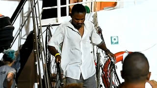 H6 migrants disembark spain rescue ship open arms lampedusa italy