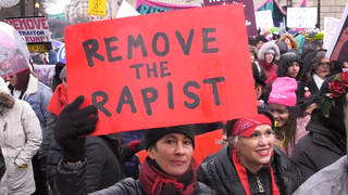 H11 protestors turn out womens march nationwide national archvies under fire doctoring photo 2017 march