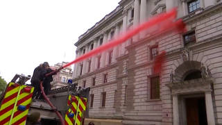 H8 london climate protest extinction rebellion fire engine fake blood treasury stop funding climate death