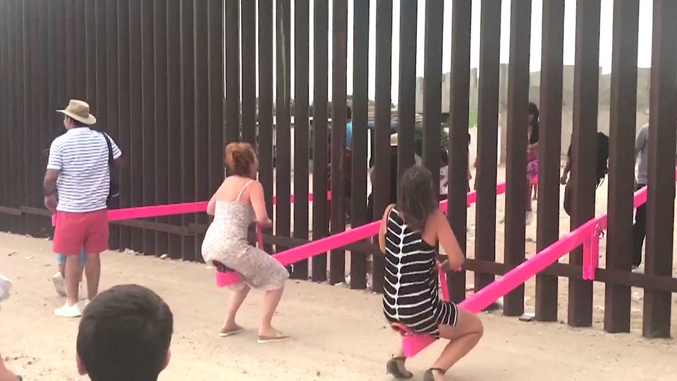 H12 us mexico new mexico border wall seesaw immigration teeter totter wall