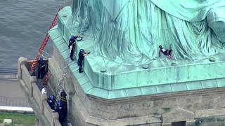 H5 statue of liberty protest