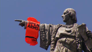 H5 spain open arms columbus statue protest