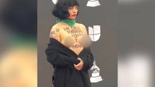 H7 mon laferte topless protest latin grammys las vegas chile violence