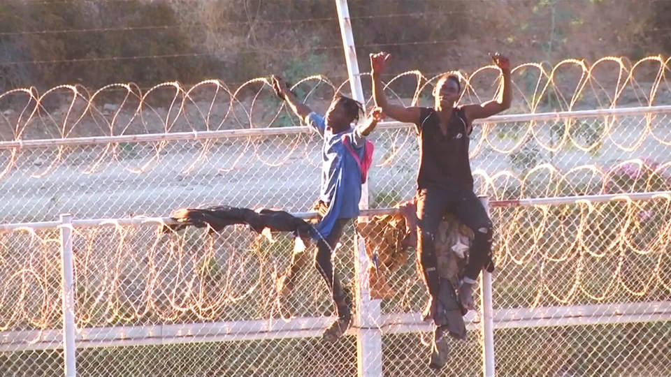 H9 refugees storm fortified spanish enclave