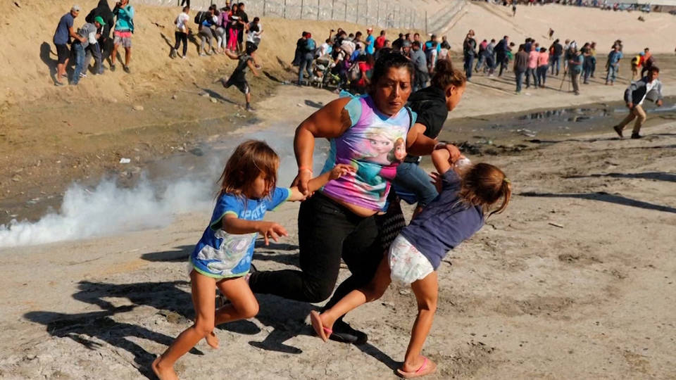 H1 migrants tear gassed