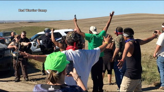 H15 standing rock hands up