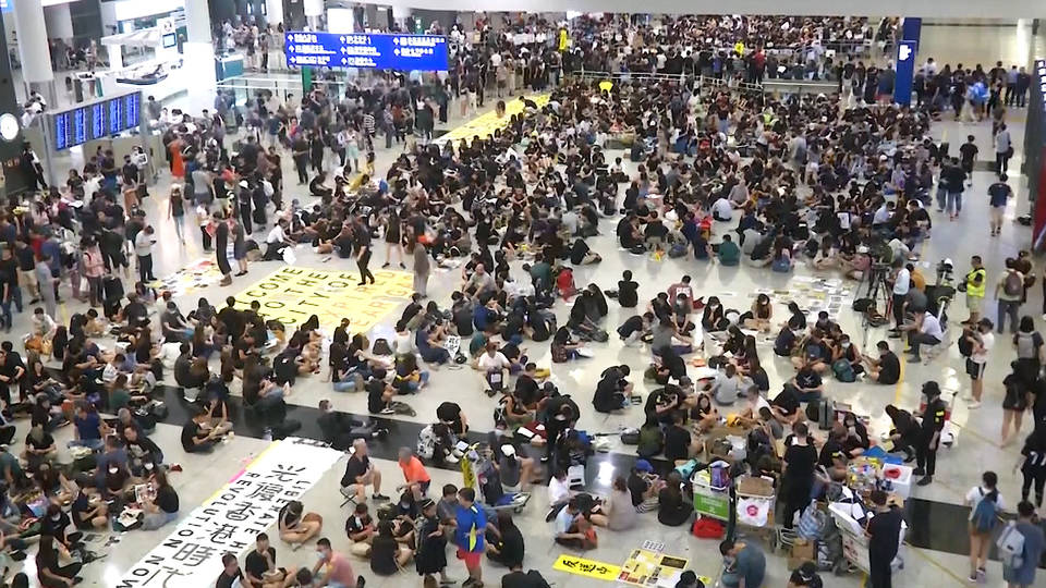 H8 hong kong protests airport sit in activists carrie lam reforms