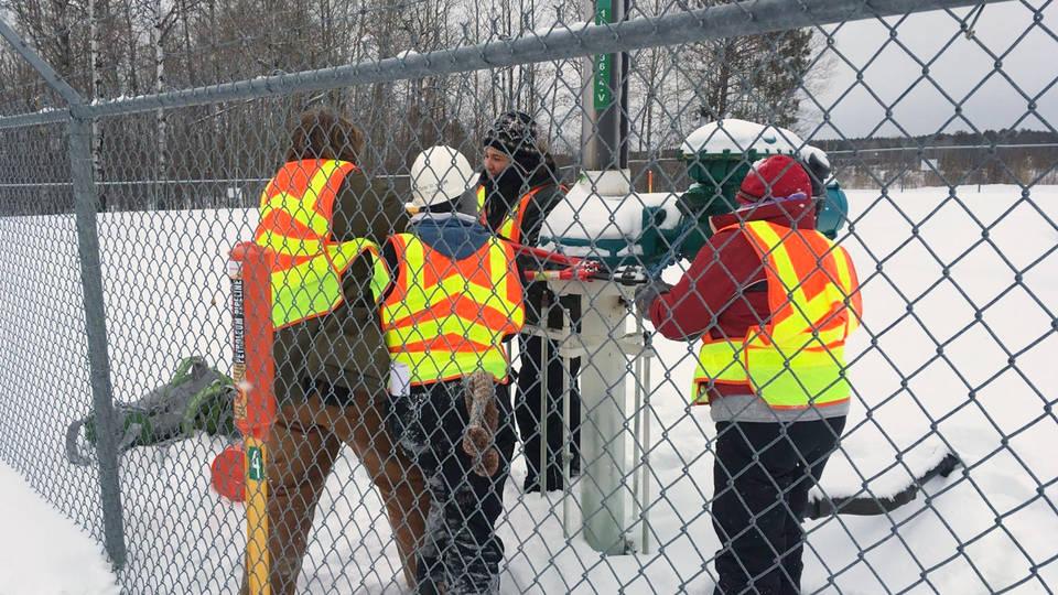 H18 activists arrested shutting off enbridge pipeline valves necessity four