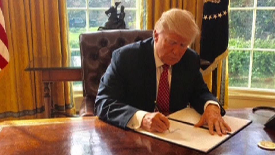 H04 trump signs order