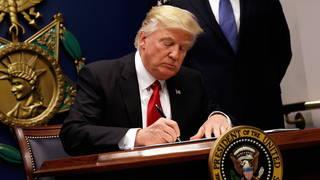 H03 trump signs ban