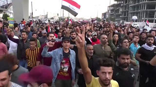 H6 iraq protest tahir square peaceful boy stabbed death strung traffic pole