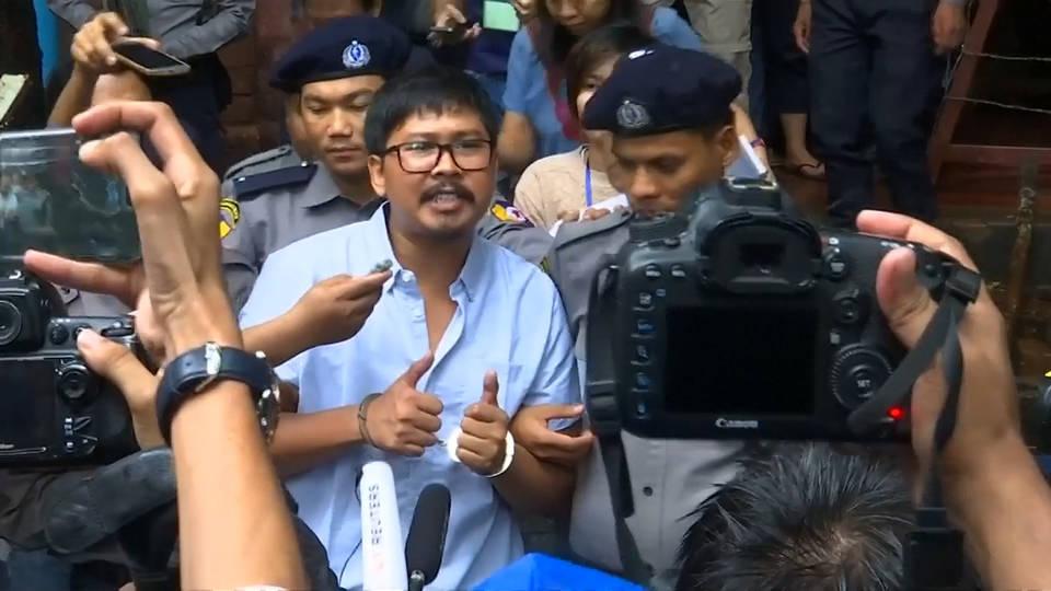 H7 burma reuters staff trial