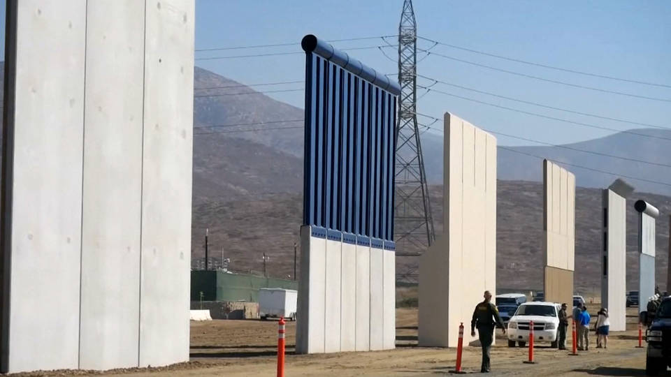 No wall win, but Trump agrees to reopen government