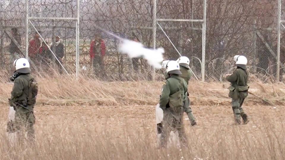 H7 turkey accuses greece killing migrant greek riot police fire tear gas border