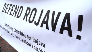 Seg2 defend rojava sign