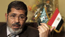 Morsi Charged with Terrorism as Egyptian Military Widens Crackdown on Journalists, Activists