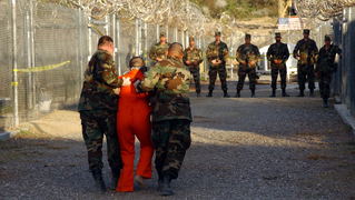 prisoner being escorted