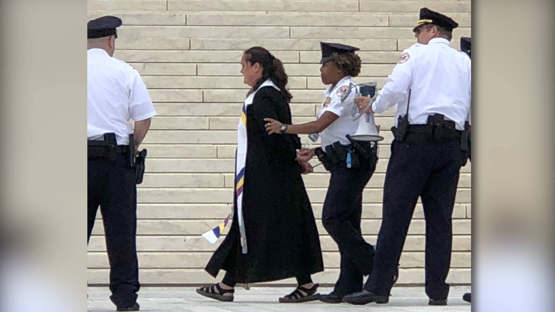 Religious Leaders Shackled, Held in Jail Overnight, After Praying in Protest Outside Supreme Court