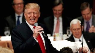 Trump smirk holding microphone