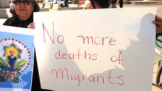 Seg1 nomoredeathsofmigrants protestsign