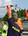 Swiss Police Cut Rope Holding British Activist Hanging From Bridge, Sending Him Falling Dozens of Feet , and Raid the Independent Media Center, Beating Journalists